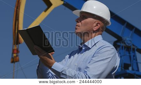Petroleum Engineer Working In Extracting Oil Industry Use Agenda In Maintenance Activity