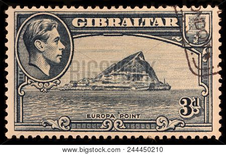 Luga, Russia - January 23, 2018: A Stamp Printed By Gibraltar Shows Image Portrait Of King George Vi