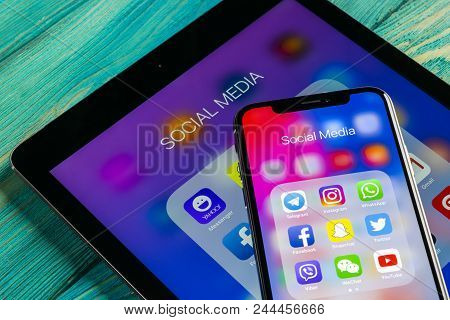 Sankt-petersburg, Russia June 8, 2018: Apple Iphone X And Ipad With Icons Of Social Media Facebook,