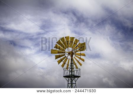 Old Metal Windmill In A Field, Detail Of Heolic Energy