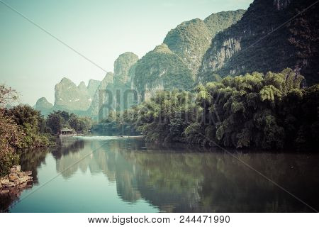 Scenic View Of Yulong River Among Green Woods And Karst Mountains At Yangshuo County Of Guilin, Chin