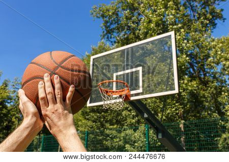 Closeup Male Hands Throwing Basketball Ball In Target Outdoors