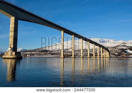 Bridge On High Pillars Connecting The Islands Around The Fjors Of Tromsø, Norway