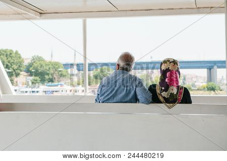 Istanbul, June 17, 2017: A Couple Of Local Residents, A Man And A Woman Are Sailing On A Passenger B