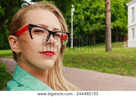 Close Up Portrait Of Sensual Blonde Woman With Red Lips, Stylish Glasses For Sight. Young Lady Looks