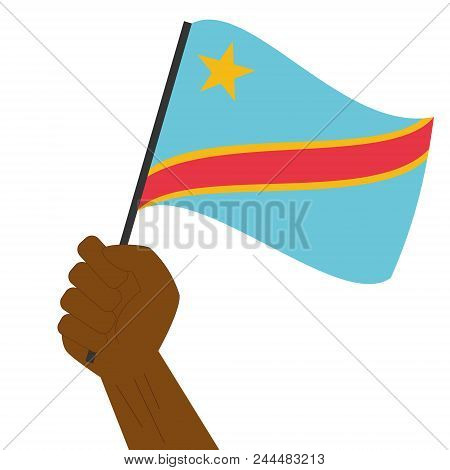 Hand Holding And Raising The National Flag Of Democratic Republic Of Congo