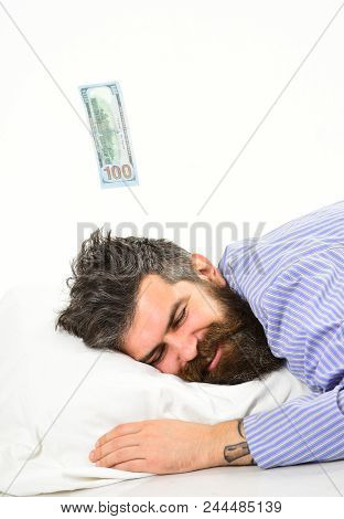 Dreaming Of Profit Concept. Man With Sleepy Face Lay On Pillow, Sleeps. Hipster With Beard And Musta