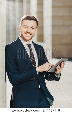 Vertical Shot Of Business Person Uses Digital Tablet For Online Communication And Work, Uses Free In