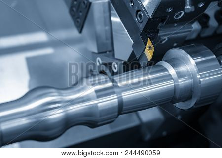 The Cutting Tool Of Cnc Lathe Machine Or Turning Machine Cutting The Aluminum Rod . Hi-technology Ma