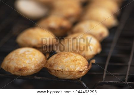 Cooking Of Sweet Coconut Rice Hotcakes On The Stove