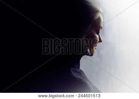 Portrait Of A Young Calm Woman In Profile. Concept Of The Inner World And Psychology, The Dark And L