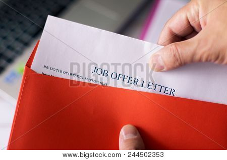 Job Offer Letter In Red Envelope. A Man Get An Offer With Hiring For Working.