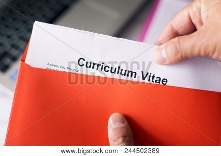 Curriculum Vitae Cv In A Red Letter. The Man Takes Out The Cv From The Envelope.