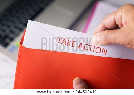 Set A Goal, Think Big And Take Action. A Man Opens A Red Letter With A Plan Of Action.