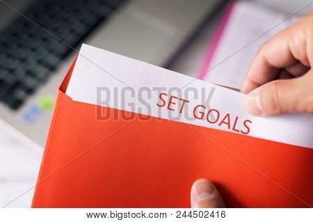 Set A Goal, Think Big And Take Action. A Man Opens A Red Letter With A Plan Of Action. Set A Goal, T