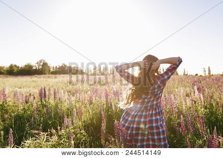 Healthy Freedom Woman Relaxing With Open Arms In Spring Sunset Field Outdoor. People Freedom Concept