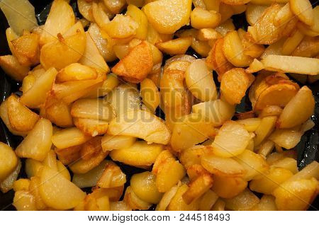 Fried Potatoes Golden Color And Crispy On Black Frying Pan