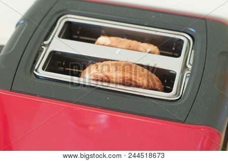 Toasts In Toaster Peer Out While Cooking