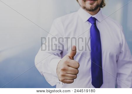 Businessman Doing Thumbs Up Sign In Front Of The Camera With Positive Winning Attitude, Image Shot A