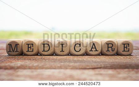Medicare Word Written On Cube Shape Wooden Blocks On Wooden Table.
