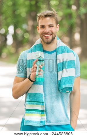 Man With Athletic Appearance Holds Bottle With Water. Sport And Healthy Lifestyle Concept. Man Athle