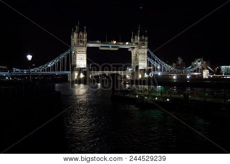 Tower Bridge With Night Illumination In London, United Kingdom. Bridge Over Thames River With Dark W