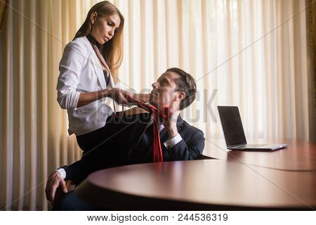 Bdsm Romance With Man In Suit And Sexy Female At Office. Woman With Sexy Leather Red Toy And Excitin