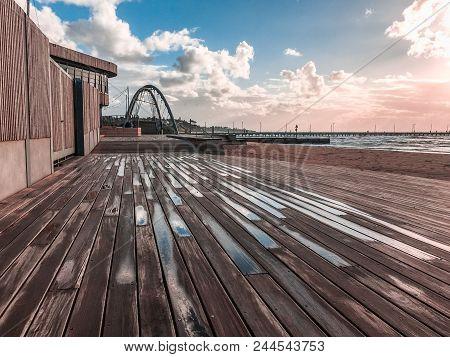 Wooden Boardwalk Near Frankston Yacht Club And Footbridge At Sunset. Melbourne, Australia