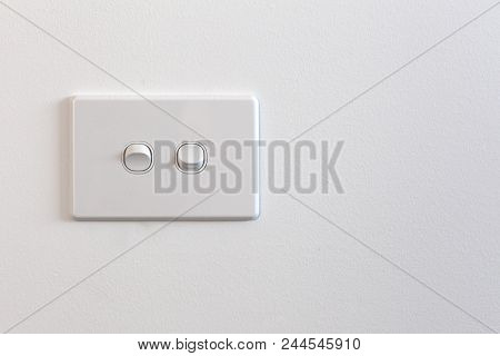 Modern Double Light Switch On White Wall With Copy Space