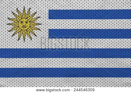 Uruguay flag printed on a polyester nylon sportswear mesh fabric with some folds poster