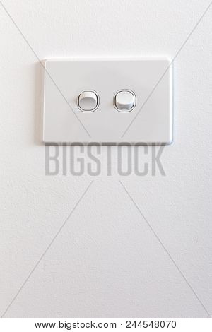 Modern Double Light Switch On White Wall With Copy Space - Vertical Image