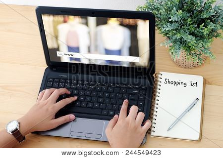 Hand Typing Laptop With Www. On Search Bar And Blank Shopping Lists Paper, On Line Shopping ,busines
