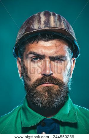Builder Working With Construction Helmet. Portrait Bearded Man With Protect Helmet Wearing. Business