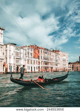 Venetian Gondolier Punts Gondola In Venice, Italy