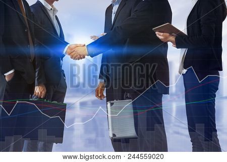 Double Exposure Business People Handshake Meeting