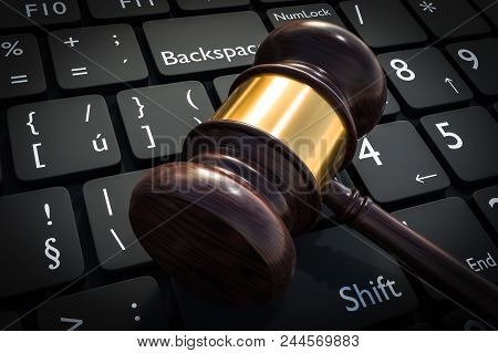Wooden Gavel And Keyboard - Justice And Law Concept. 3d Rendered Illustration.