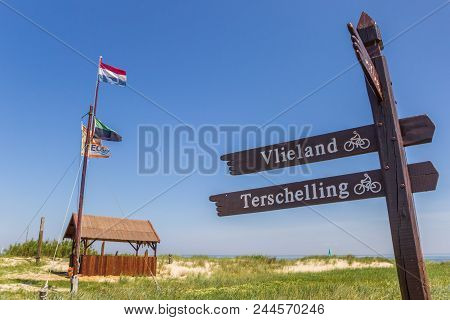 Texel, Netherlands - June 07, 2018: Signpost To The Ferry From Texel Island To Vlieland In The Nethe