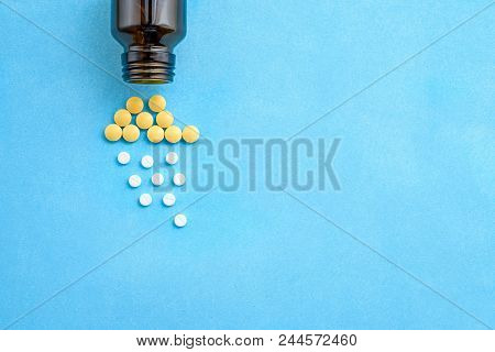 Pills And Pills, The Concept Of Health Disorders-a Symbol Of Poor Health On A Blue Background