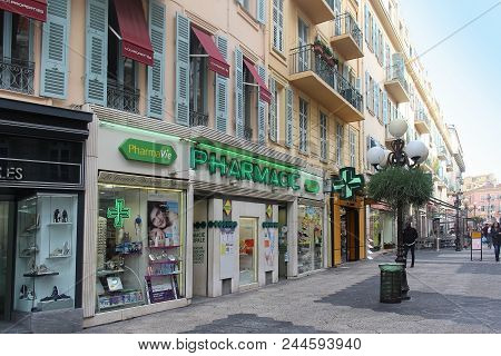 Nice, France - February 03, 2016; Local French Pharmacy On Walking Street In Nice With Glowing Sign