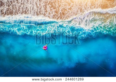 Aerial View Of Woman Swimming On The Pink Swim Ring In The Transparent Sea In Oludeniz. Summer Seasc