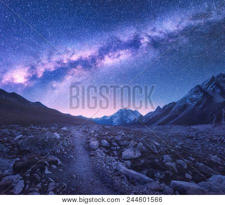 Milky Way And Mountains. Space. Amazing View With Mountains And Starry Sky At Night In Nepal. Trail