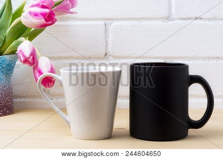 Black Coffee Cup And White Latte Mug Mockup With Magenta Tulip