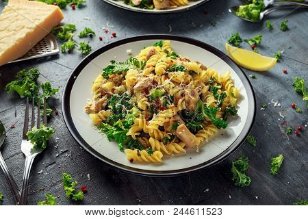 Homemade Pasta Fusilli With Chicken, Green Kale, Garlic, Lemon And Parmesan Cheese. Healthy Home Foo