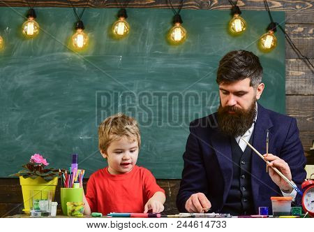 Daddy Artist Teaching His Son How To Paint. Blond Kid Learning To Draw