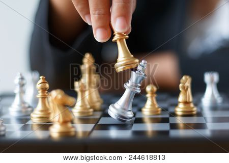 Close Up Shot Hand Of Business Woman Moving Golden Chess To Defeat And Kill Silver King Chess On Whi