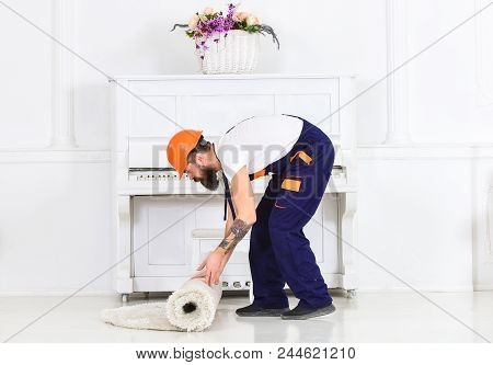 Relocating Concept. Courier Delivers Furniture In Case Of Move Out, Relocation. Man With Beard, Work