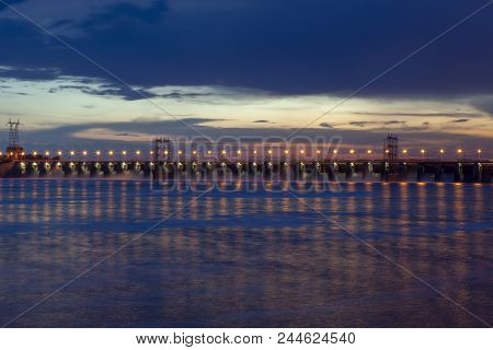 Night Photo Of The Dam, Sross Water, Clouds At Sunset, Leaden Water Surface.