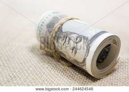 Roll Up Of Money Yen Banknote On Brown Woven Fabric, Business And Finance Concepts, Money Market In