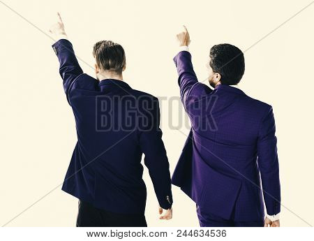 Business Partners. Men In Suit Or Businessmen Raise Hands And Point With Finger, Rear View. Business