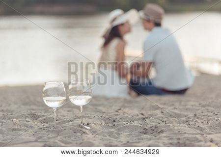 Crystal Glasses Of Champagne On The Wedding Reception Table With The Sea Background